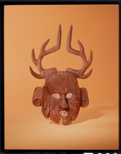 Wooden deer mask. Found here.