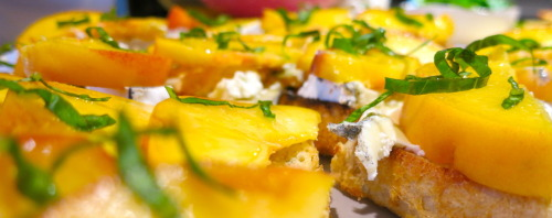 Simple Summer Peach Bruschetta.  For the longest time I thought bruschetta was a strict thing: bread, tomatoes, basil, garlic.  Done.  Really, it is any type of goodness you desire stacked on top of grilled bread, usually served as an app.  Well, this sure opens things up, doesn't it?  Why not peaches?  Or cheese?  Or peaches and cheese?  Now we're on to something.  Experiment at will, as that is where the fun is, but below is what I created above. Grilled bread - brush your grill grates and your bread a bit with olive oil and grill away till your have a few nice crispy spots Top with soft cheese, I used Humbolt Fog Top with fresh sliced peaches Squeeze a little lemon juice over the top and finnish with fresh cut basil