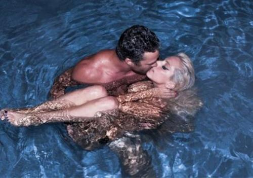 Is Lady Gaga nude in a pool kissing Taylor Kinney? Does it matter? Is it still an awesome picture of Lady Gaga regardless? Reblog with your thoughts!