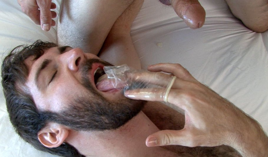 Hairy fag licks the condom clean