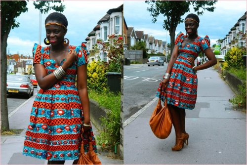 This here is a great example of incorporating African textiles into modern day styles. By matching the bold prints with a nude shoe and bag, and simple jewelry, she is able to create a beautiful chic outfit that she can easily wear to the office or for a nice day out! To find similar items, try NZINGA'S! Located at 827 N. Market St, Wilmington, DE 19801. Stop by to see what's in or visit our website!