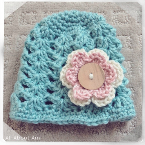 "I've been having so much fun whipping up baby hats, and here is one of my favourites!  The ""Shell Stitch Beanie"" by Betsy of The Dainty Daisy is so beautiful, and the pattern is available for free HERE with sizing for 0-3 months, 3-6 months, 6-12 months, 12-3 years and even 3-10 years!  The one I made in this photo is for 0-3 months, but I am so tempted to make more in each size :)  The shells are so delicate and pretty and the addition of the double-layered flower makes this hat even more sweet!"