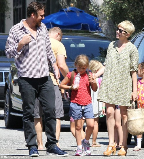 When are these people not being adorable? Here they are leaving Matilda's gymnastics class and — in classic Ledger-Williams-Segel fashion — smiling. I wonder if Michelle Williams realizes how good her life would be if she could just find a flattering shirt silhouette for her boyfriend and some non-drawstring shorts for her daughter.