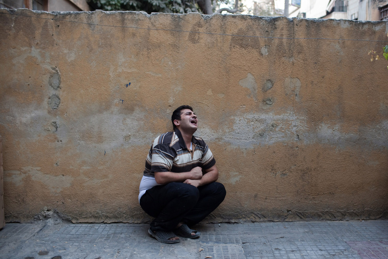 The brother of Abdul Latif Qureya, who was killed, mourns the loss of at least seven family members Photographer Nicole Tung writes for LightBox about the horror she witnessed during the battle between Assad loyalists and the Free Syrian Army in Aleppo, Syria.  See more photos here.