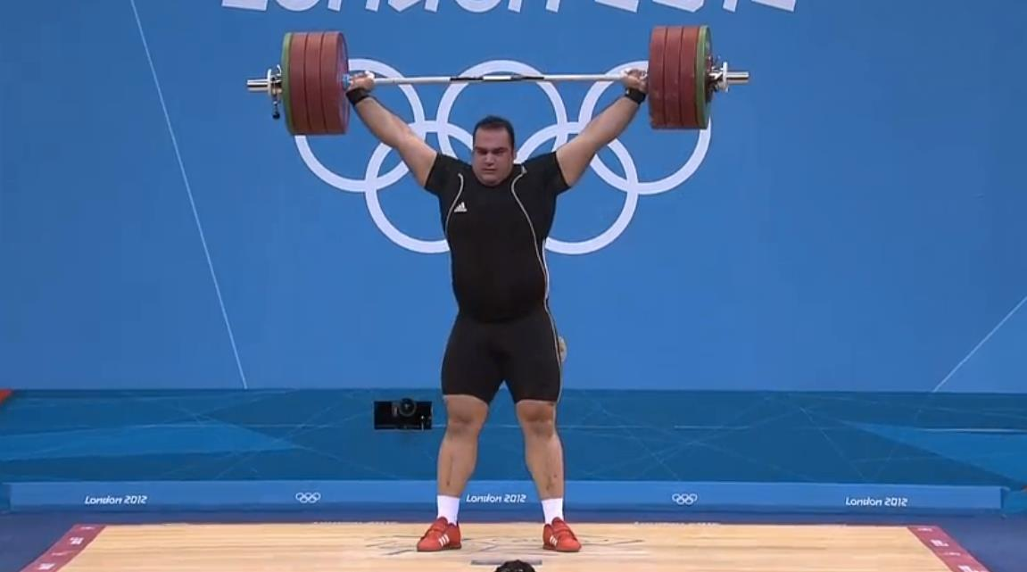 Behdad Salimi (105kg+, Iran) takes gold with a 208kg (457.6lbs) snatch and a 247kg (543.4lbs) C&J for a total of 455kg (1,001lbs).  With an additional attempt, he took a shot at the world record C&J of 263kg but missed the lift. Un. Freaking. Believable.