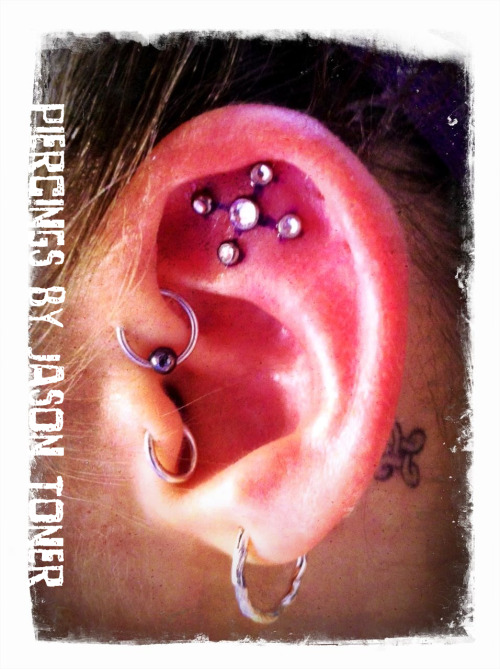 JT just did this cool ear project at work today. One 5mm CZ gem and four 4mm CZ gems. (ignore the blue lines, since photo was taken right after it was done.