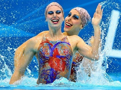 Synchronized Swimmers Look Creepy I bet they talk at the same time too, like those twins in The Shining.