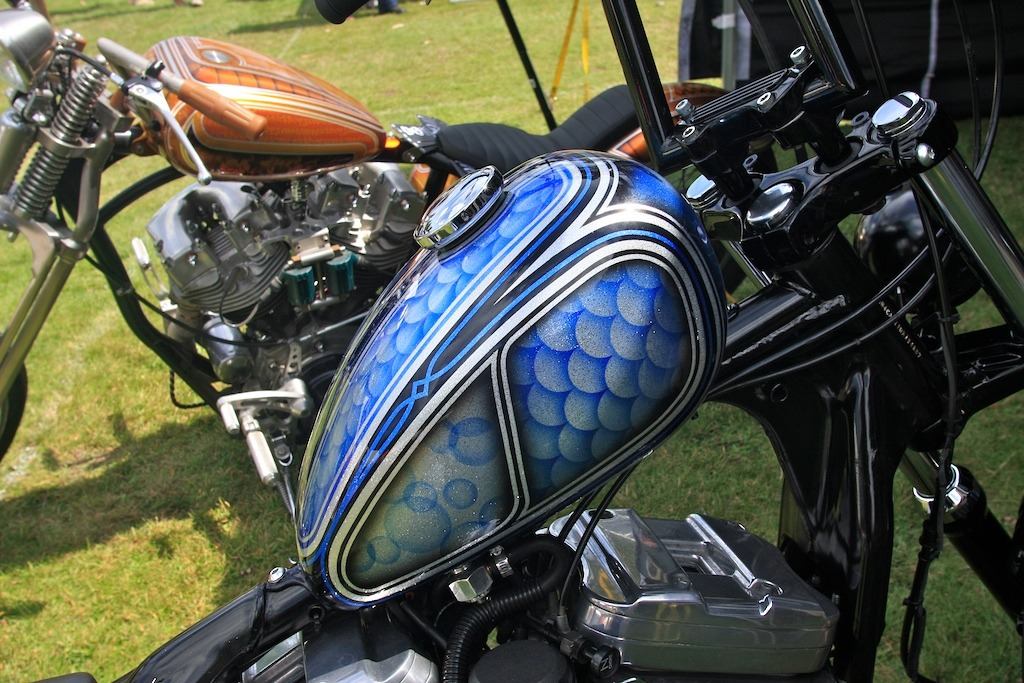 Sick Boyz Custom UK. Nice paint on these two gas tanks. Shot this weekend at the South Of England Rally.