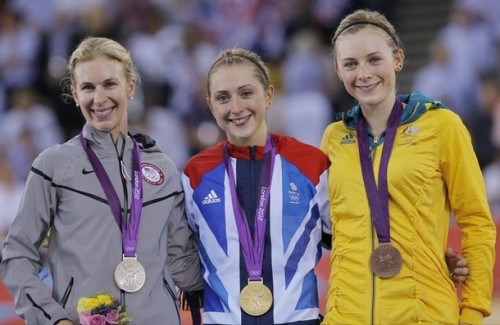 Britain's Laura Trott, center, poses for photographs with Silver Medalist Sarah Hammer, of the United States and Bronze medalist Annette Edmondson, of Australia, during the medal ceremony at the 2012 Summer Olympics in London, Tuesday, Aug. 7, 2012. (via Photo from AP Photo)