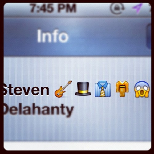 this is what @stevendelisandwich puts himself in my phone as #iphone #contact #guitar #hat #tophat #shirt #tie #dresshsirt #japanese #komodo #gown #suprized #face  (Taken with Instagram)