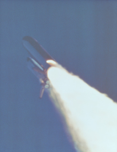"Challenger on the way up for the last time, January 28th, 1986. The exhaust plume from the SRB is clearly visible.(irrelevant side note: my sister was born nine days earlier, so I make a habit of pointing to the Challenger disaster and saying ""look what you did?"")"