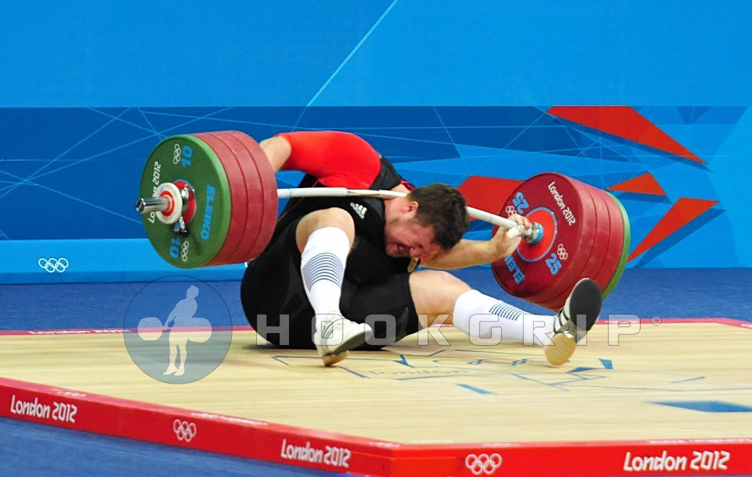 File this under: I WOULD BE DEAD  Matthias Steiner (105kg+, Germany) drops 196kg on his neck. Yea…  432 pounds.  On his neck.  Steiner, the defending Olympic Champion, managed to walk away but he was unable to continue in the competition.  Until NBC has it removed, here is a video someone uploaded.  When I saw this, I really thought he would be back for the C&J.  I mean, the guy gets up and shakes it off, or so it seems.  He was officially listed as DNF.  Kinda sad, because I was really looking forward to watching him compete. Article and photos here.