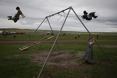 Girls on the Swings, Surprise Creek Colony, Stanford, Montana (2005) - William Albert Allard