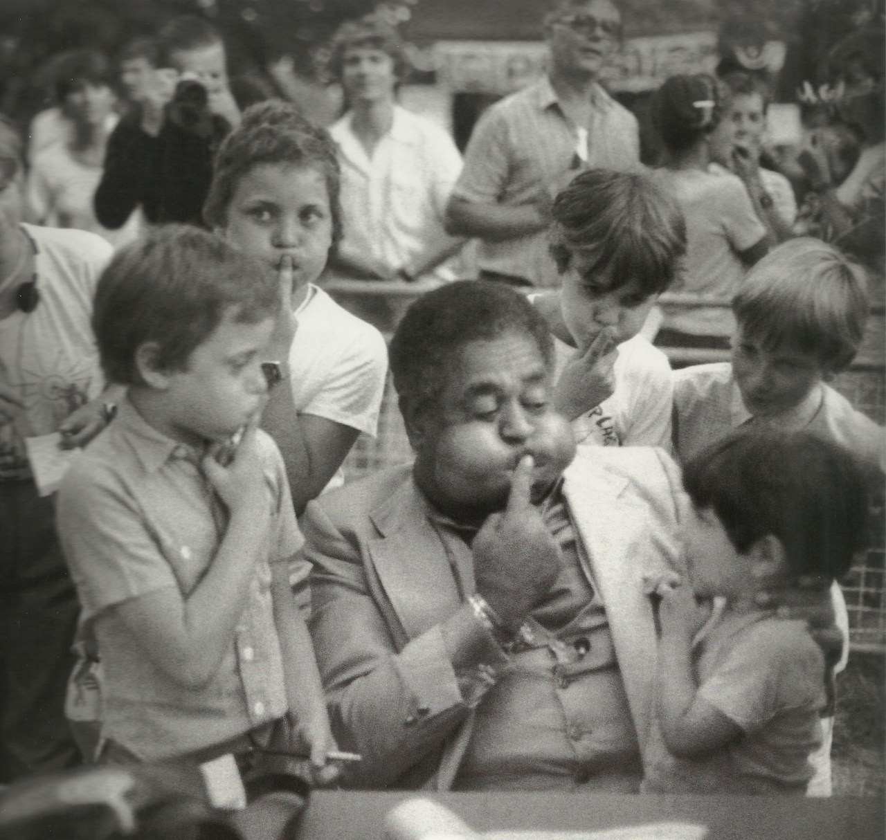 missjazzage:  French kids imitate Dizzy Gillespie's cheeks in Nice, France; 1981 | Taken by Milt Hinton.  Put your lips together and blow …