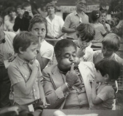 missjazzage:  French kids imitate Dizzy Gillespie's cheeks in Nice, France; 1981 | Taken by Milt Hinton.
