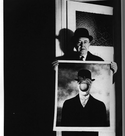 Portrait of painter Magritte with his painting by Bill Brandt.
