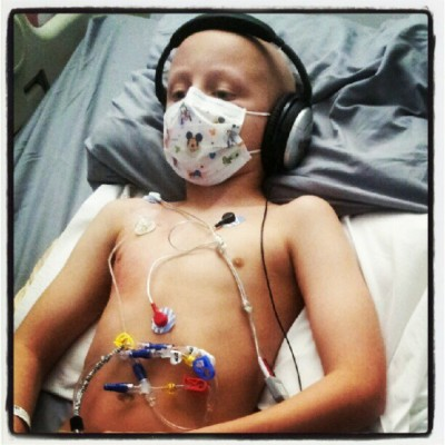 "This was taken during round 4 of chemo for Stage IV Neuroblastoma. He did great the whole round which was actually pretty short. We were very excited that he would be coming home quickly and we were expecting a large break between round 4 and 5. Things did not turn out the way we had hoped unfortunately and 4 days after coming home Jayson started having some stomach pain. The medications he had gotten in round 4 of chemo can cause all kinds of problems, and all kinds of problems is exactly what it caused. What started out as a belly ache from what we thought was constipation quickly turned into extreme pain which had him doubled over begging for his extra strong pain medication. We rushed him to Loma Linda's ER where after a very uncomfortable night in the ER they moved him upstairs and determined that he had gotten Typhlitis (inflammation of the large intestine that can come from infection). Basically a portion of his bowels totally stopped working and it eventually begins to rot if not dealt with in a very aggressive manner. He started off with a few different medications but every day they would add another machine to his IV pole which would provide a different type of medication. They kept him NPO (no food and water) for 7 days. They wanted to give his bowels a chance to rest and allow them to start repairing themselves. When a person goes through chemotherapy the goal is to completely wipe out their white blood cells (all fast growing cells) which is what causes them to loose their hair, have issues will mucus membranes and the biggest side effect is it kills their entire immune system. This is what we battle everyday. Because he has no immune system his body got worse before it started to get better. His belly got swollen because his bowels were basically rotting, he got a fever, he was in agony and needed strong pain medication. They took new x-rays daily to monitor his progress and to make sure the problem was getting better and not worse. So after quite a few days we started to see improvement. His fever went away and the swelling in his belly went down. His pain got less and less and his x-rays and CTSCAN showed slight improvement. The doctors decided Jayson could start a liquid diet but he would still need to stay on IV nutrition to maintain his daily intake. He did pretty good and the next day they decided he could start a soft diet. This is where the trouble started once again. Jayson can't drink liquids and he can't eat anything without it coming right back up again. He can't walk very far without getting sick and being very weak. We are 11 days into our hospital stay and tomorrow my boy will go in for another procedure. They will put him under once again and send a scope down his throat and they will try to figure out what is causing the extreme burning sensation in his throat and why within minutes of eating or drinking does it all come back up again. The inside of his mouth was covered in sores (common for kids in chemo) and his gums were terribly swollen, it is possible that he has the same sores down his esophagus or it's possible that he has inflammation. We will find out tomorrow. Jayson is due to start round 5 of chemo next week which will have to be put off for awhile. We don't know if he will get any time at home between now and then but we are hopeful. We have learned that there really is ""no place like home"" and that Jayson tends to heal much faster when he is at home with his family and his things then when he is stuck in a hospital bed.  We learned today that another little warrior that had fought Neuroblastoma 2-3 times had quietly passed this morning surrounded by her family after a very long and brave battle. She was a beautiful little girl. I had only learned of her a few days before her passing but reading her story through her mother's posts on facebook and watching the videos of her on her mother's page made it impossible not to fall in love with her instantly. RIP Isabella Rinier!"