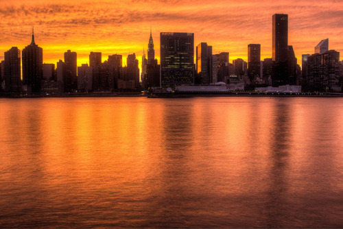 thatlostguy:  Manhattan Inferno by skingld on Flickr. 8/7/12…. beautiful sunset across manhattan