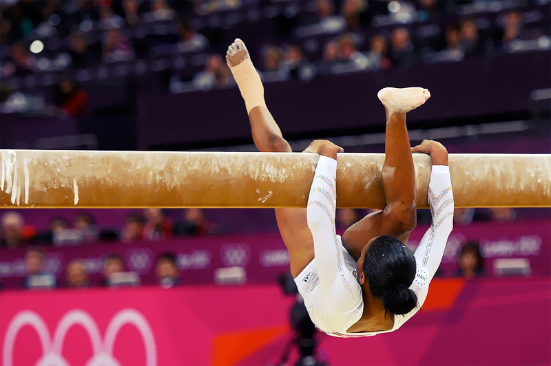 OLYMPICS DAY 11 All-Around Gold medalist Gabby Douglas of the United States falls off the beam during the Gymnastics Women's Beam finalPhoto by Michael Regan ——- So proud of her though! She fought tooth and nail to stay on that beam.