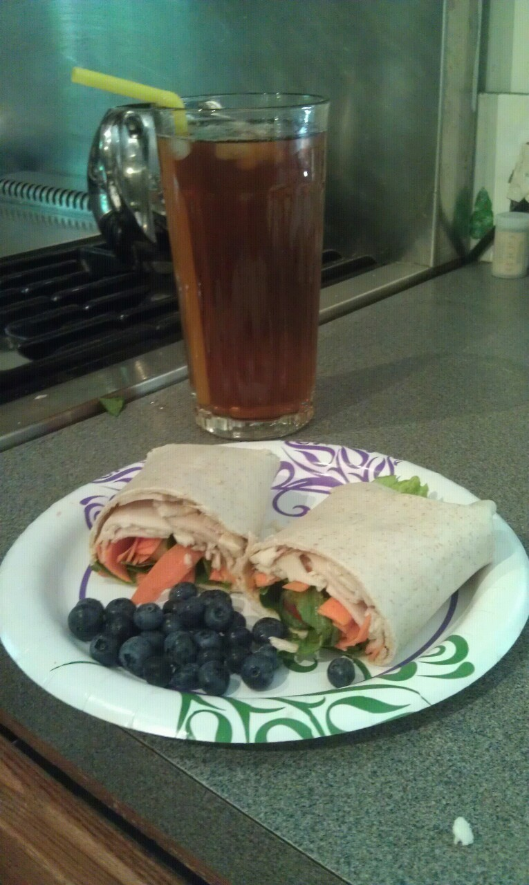 Homemade iced green tea and a veggie and turkey wrap with a bit of red pepper hummus with blueberries!