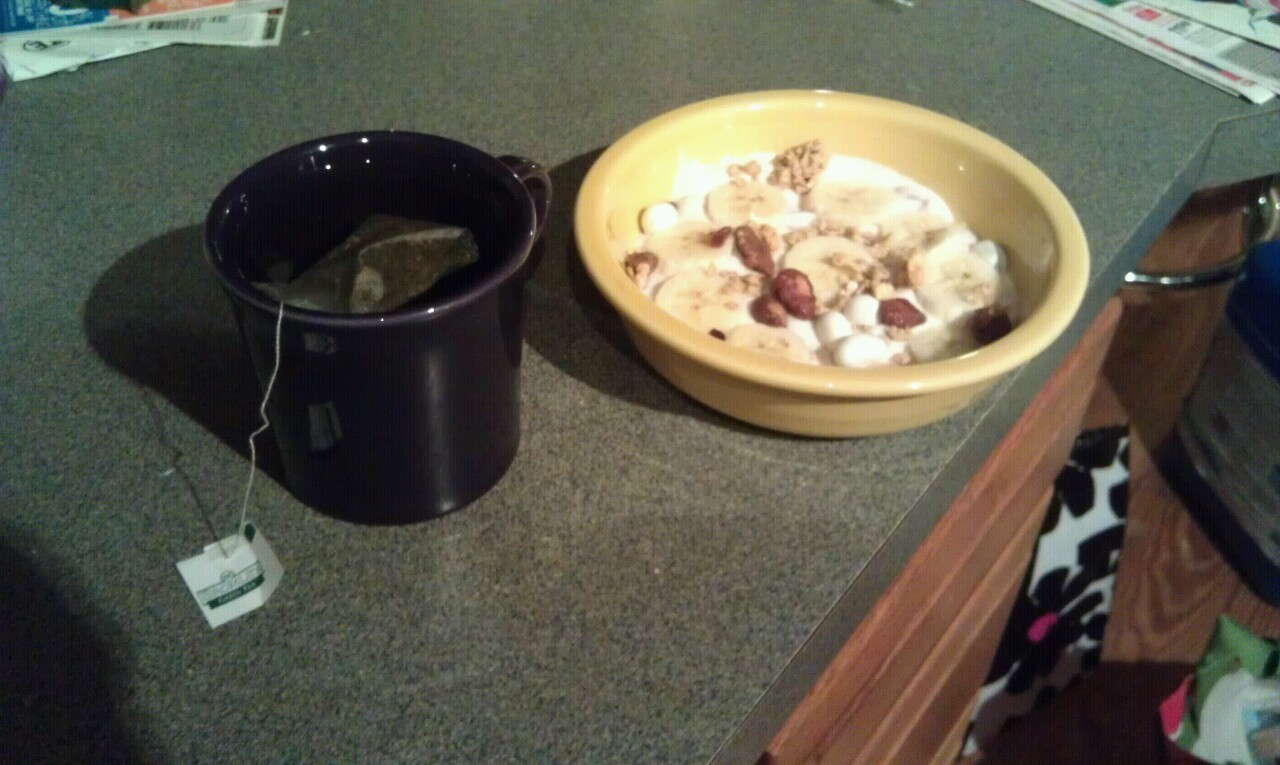 Green tea and granola and banana on greek yogurt!