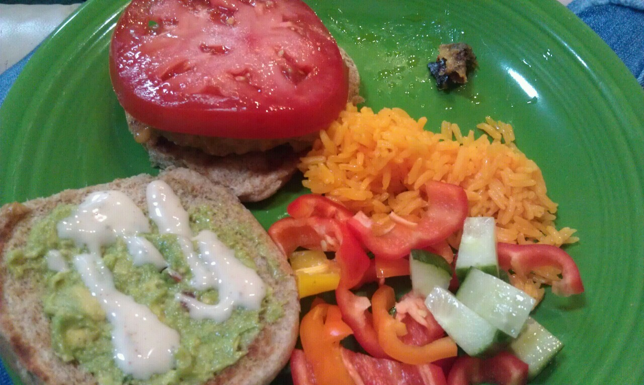 Guacamole on a lean burger with cheese, jasmyne rice and veggies