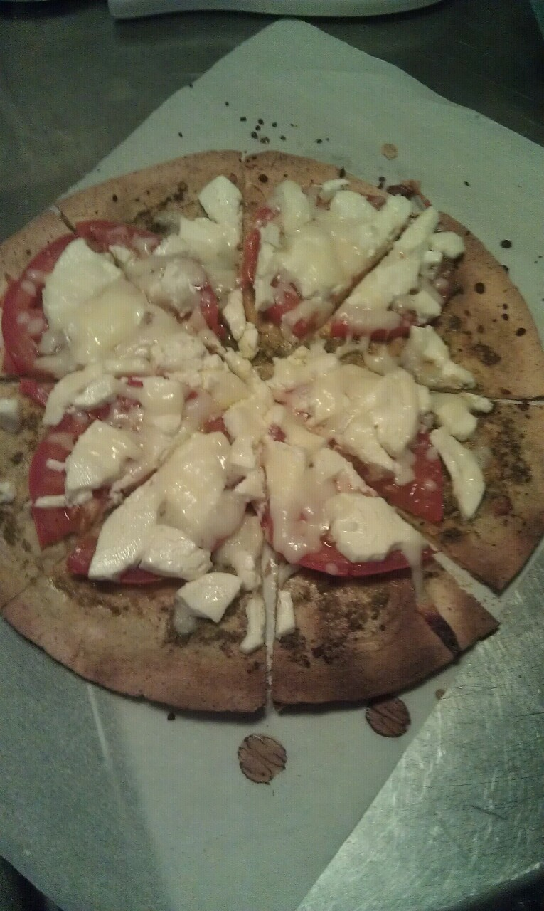 pesto pizza with tomato! A little overdone but still yummy!