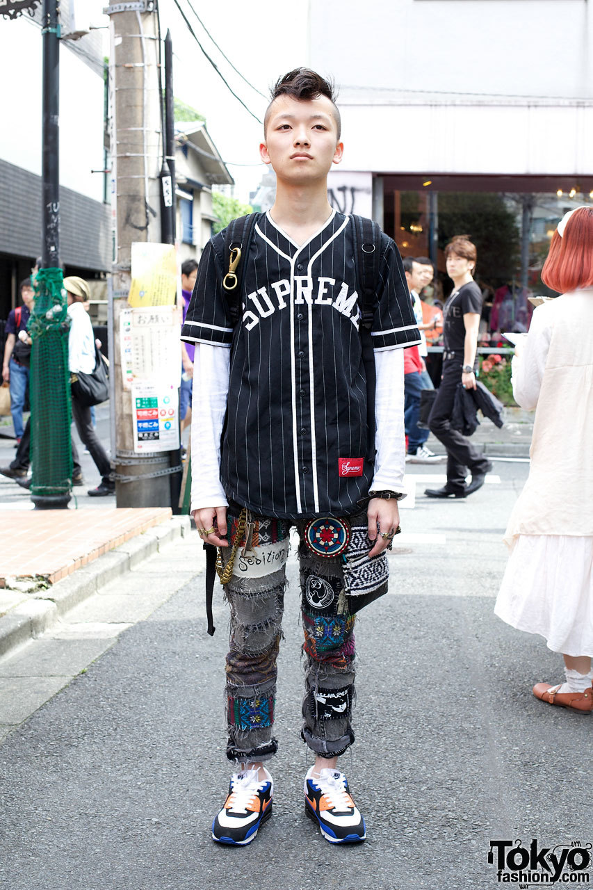 21-year-old Harajuku guy wearing Supreme, Undercover & handmade patched jeans.