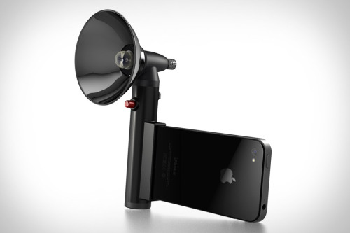 thenextweb:  The Paparazzo iPhone Light ($50) is designed to give your photos a boost by replacing it with a 300 lumen LED light that connects to your iPhone's dock connector, adding a dedicated shutter button and handy grip in the process. (via Paparazzo iPhone Light | Uncrate)