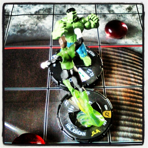 So we are learning how to play Heroclix. Marshall has the basics down and is teaching my how to play. I have the fast forces Hulk set and he purchased the Green Lantern set. We also have several Avengers models as I have been opening boxes randomly. I am going to purchase a big brick so I can get one of the big models. The Batman Heroclix recently released and they are doing a league you can play in to earn limited edition models and a few lucky winners will win a BATCAVE! Marshall is a huge Batman fan and he just has to have that Heroclix Batcave so we are gearing up to play in the league!