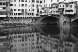 A black and white Ponte Veccio in Florence, Italy. One of the oldest marketplaces in the world.