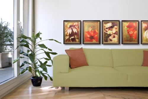 It is common to surround sets of art in identical frames. When it comes time to place them on the wall, create an arrangment that provides the symmetry or balance you like best.