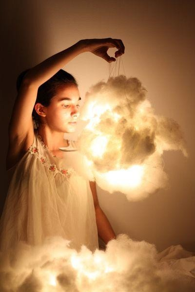 cptfunk:  lolololori:  Cloud Lights - First, you need some cotton batting, a paper lantern, and three flameless candles, the type that Glade sells. Pull at the cotton batting until it looks fluffy, light, and cloud-like. Then, hot glue it to the outside of the paper lantern in various places. Make sure it´s fluffed to your liking, then light the lights and stick them inside. Hang the lantern wherever you´d like.  I am makin' the SHIT outta this lamp.