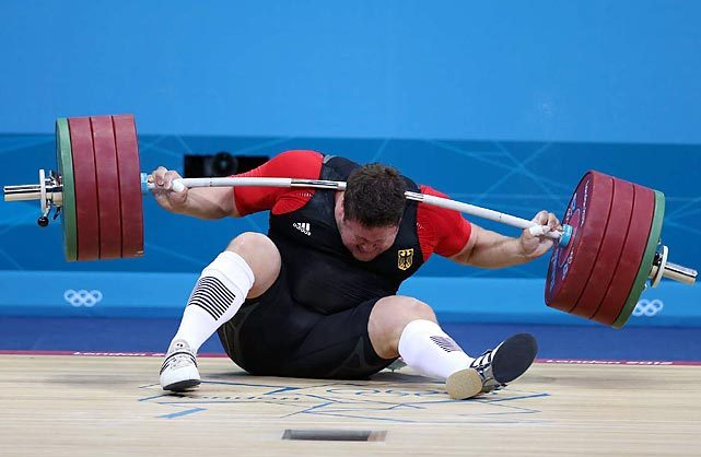 During competition on Tuesday, Defending Olympic weightlifting champion Matthias Steiner of Germany lost his balance while trying to lift about 432 pounds and was hit in the neck by the barbell. He got up on his feet and waved to the crowd but later withdrew. SI photographer Simon Bruty captured the entire sequence while shooting the competition. GALLERY: Matthias Steiner's Weightlifting Snafu Sequence FARBER: In sport of strong men, Iran's Salimi stands alone