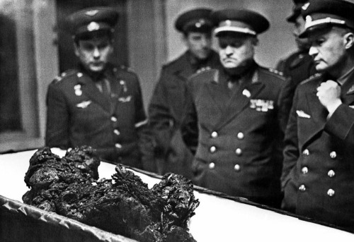 "juanwaystreet:  Open casket funeral of cosmonaut, Vladimir Komarov  been obsessed with this story all morning after seeing this photo. more information here, including audio clip of Komarov's (questionable, as you'll later read) ""cries of rage as he [plunges] to his death"": http://www.npr.org/blogs/krulwich/2011/05/02/134597833/cosmonaut-crashed-into-earth-crying-in-rage revisions here: http://www.npr.org/blogs/krulwich/2011/05/03/135919389/a-cosmonauts-fiery-death-retold"