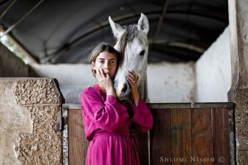 """A young girl with a white horse"" by Photographer Shlomi Nissim   What a talent! I just adore his art.."