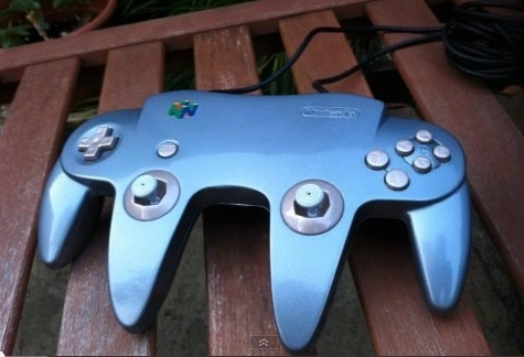 The Human Centipede Of N64 Controllers UK modder Clarky mutated two N64 controllers together so that his friend could play Star Wars: Episode One Racer. See, there's a code you can put into the game that lets you control both Pod Racer engines using analog sticks from two controllers. If old-ass Star Wars games aren't your thing, then you'll be happy to know that, yes, this controller also works with Goldeneye. Check a video of the controller in action below.  (via Kotaku)