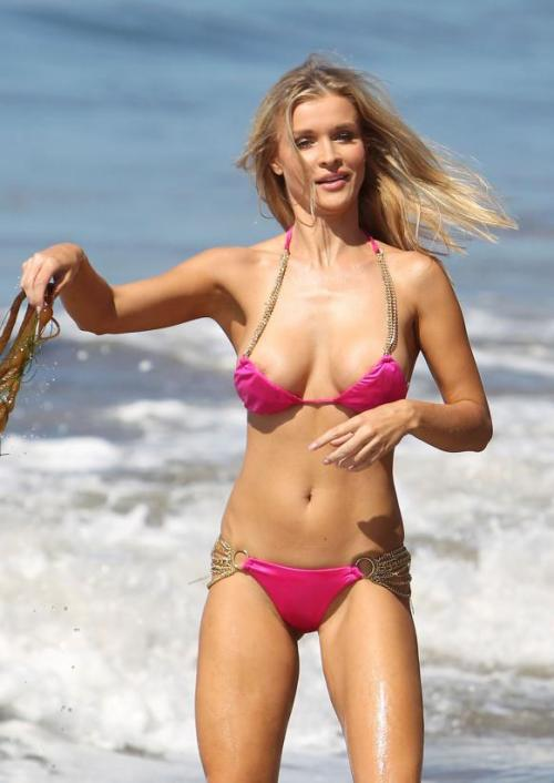 Check out Joanna Krupa in a bikini that seems to be slipping off… Joanna is part of the latest Housewives series from Bravo TV, The Real Housewives of Miami. Click the pic for more photos!