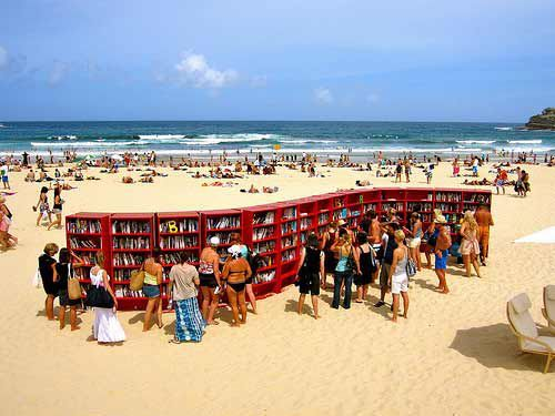 doubledaybooks:  Books at the beach!  I might actually go to the beach if there were more beaches like this! ^KE