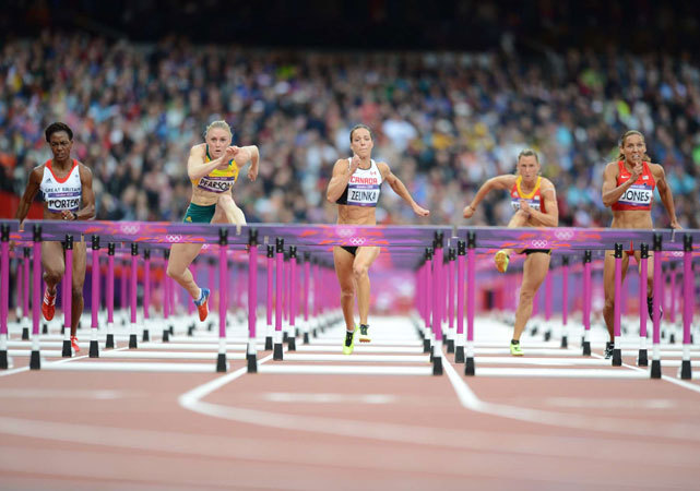 Competitors in the women's 100 meter hurdles - (from left) Tiffany Porter, Sally Pearson, Jessica Zelinka, Eline Berings and Lolo Jones - compete during the semifinals on Tuesday. Pearson would capture gold, while Americans Dawn Harper and Kellie Wells took silver and bronze. Lolo Jones finished fourth. (Peter Read Miller/SI) LAYDEN: Jones misses glory in 100 hurdlesGALLERY: Rare Photos of Lolo Jones