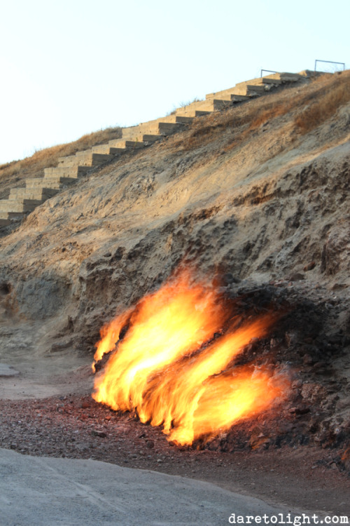 Natural gas seeps from the foot of the Yanar Dag mountain, blazing continuously.  - near Baku, Azerbaijan