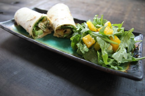Arugula yellow pepper, avocado, olive & hummus wrap. It's what's for lunch