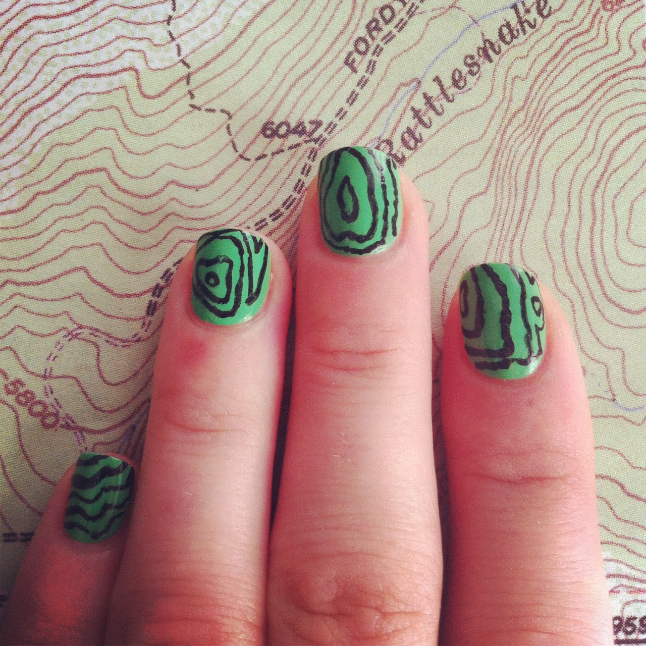 Something super fast to get back into the nail art game. Kind of looks like a topography map!  Essie: Mojito Madness, Sally Hansen nail art pen