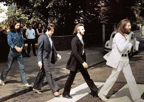"behindthegrooves:  On this day in music history: August 8, 1969 - The Beatles take the cover photo for their 11th studio album ""Abbey Road"". While the band are recording the album, they had been trying to decide what to title their latest work in progress as well as what to put on the cover. Finally the decision is made to pose for the album cover photo in the zebra crossing right in front of the EMI recording studio on Abbey Road. A photo shoot is quickly organized and photographer Iain McMillan is hired for the job. On the morning of the 8th, prior to beginning a recording session scheduled for 2:30 that afternnoon (the band are recording overdubs for ""I Want You (She's So Heavy)"", ""The End"" and ""Oh! Darling"" that day), McMillian will stand on a step stool in the middle of the street, while a policeman holds up traffic as the photos are taken. The Beatles will cross the road twice while McMillan takes six pictures, with the photo shoot lasting only ten minutes. Paul McCartney will look over transparancies of the pictures taken and select the shot used for the cover. The album cover will become iconic and one of the most imitated and parodied images of all time."