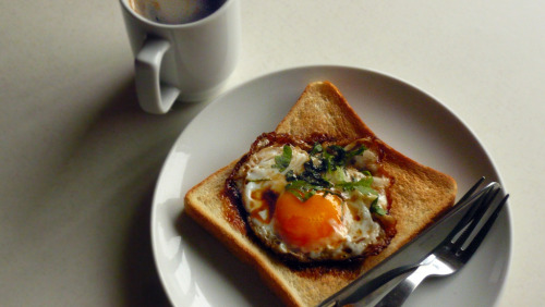 f-word:  sunny-side up egg on toast with eel sauce and shiso alongside coffee photo by eateatsleep