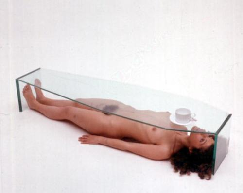 #Art of the day: #Provocative nude woman under coffin glass coffee table..