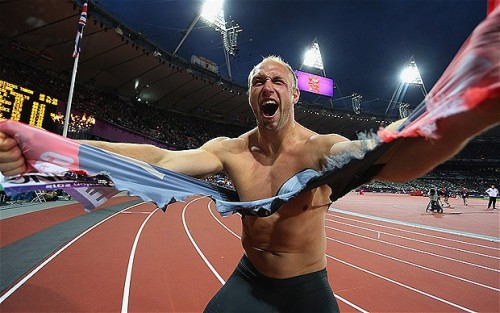 Germany's Robert Harting hulking out after winning Gold in the Discus…and then spent the night in a London train station to cap things off! Awesome!