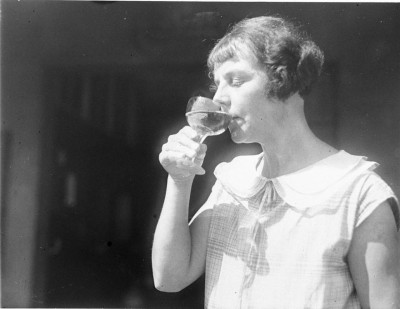 Woman drinking wine, by Sam Hood