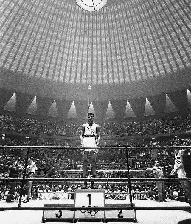 Cassius Clay stands on the podium after winning the gold medal at the 1960 Summer Olympics in Rome. The U.S. boxing team of 2012 could've used Clay as they didn't win a single medal despite sending 12 men to compete. SI's Chris Mannix suggests that if the U.S. wants to turn things around in 2016, it needs to select a long-term coach, incorporate personal coaches and recruit past legends like Oscar de la Hoya to train the new crop of Olympic boxers. (Marvin E. Newman/SI) MANNIX: USA boxing has plenty to do after first Olympics without a medalGALLERY: The Best of Muhammad Ali | Tribute to Muhammad Ali