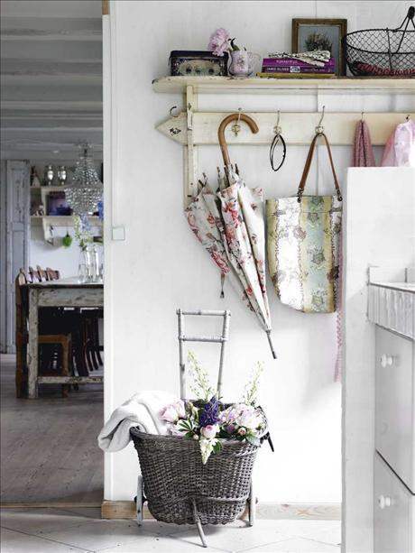 lovely shabby entryway with a floral umbrella
